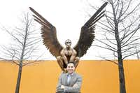 Benjamin Espino, the general manager at the Latino Cultural Center, is photographed in front of Archivaldo by Mexican sculptor Jorge Marín at the Latino Cultural Center Plaza in Dallas.( Staff photo by KYE R. LEE   -  DMN )