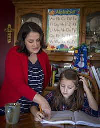 Maria Kahlig (left) helps her daughter, Molly, with a math lesson at their home.( Staff photo by G.J. MCCARTHY   -  DMN )