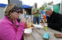 Richardson residents Frances Eubanks (left) and her husband Gary Eubanks (right) have lunch Saturday while they talk with Kat Hume-Consigliere, who works at the Richardson Food Truck Park.( Jae S. Lee  -  Staff Photographer )