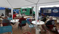 Patrons have their lunch Saturday at the Richardson Food Truck Park, located in the city's Interurban district.( Jae S. Lee  -  Staff Photographer )