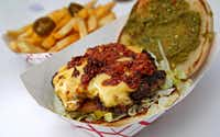 A Diablo Burger with cheese fries is made by NVN Burgers, one of the food trucks at the Richardson Food Truck Park on Saturday,(Jae S. Lee - Staff Photographer)