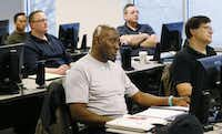 Andrew Brown (center), an army veteran, and other veterans participate in a computer training class. The initiative comes thanks to a $132,737 Veteran and Industry Partnership grant from the Texas Workforce Commission designed to create jobs for veterans and supply a more skilled workforce.( Staff Photo by Kye R. Lee  -  DMN )