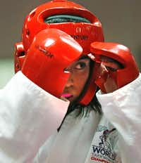 Daisy Garcia, 16, works on her technique during an advanced class of taekwondo at Plano Sports Authority. Daisy won a gold medal at the 2013 championships in England. She said she is determined to win again this year.( Staff photo by Andy Jacobsohn  -  DMN )