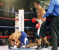 Mike Tufariello Jr. (right), of Carrollton, knocks out his opponent Kyle Fancher of Dallas, during the first round of Tufariello's first professional fight at the College Park Center on the UTA campus in Arlington on Friday night, June 28, 2013.  (Stewart F. House/Special Contributor)