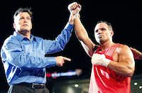 Mike Tufariello Jr. (right), 38, of Carrollton, is announced as the winner by the referee after Tufariello scored a knock out during the opening round of his first professional fight at the College Park Center on the UTA campus in Arlington on Friday night, June 28, 2013.  (Stewart F. House/Special Contributor)