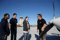 Aviation mentor Jeff Hanson (right), an American Airlines captain, goes through a preflight check with McKinney ISD students Brandon Williams (from left), Anthony Gonzales and Katie Leckey.(Staff photo by ANDY JACOBSOHN - DMN)