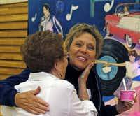 Carman Moran (right) of Addison gets a hug from Doreen Cluck of Addison at the City of Addison's 60th Anniversary Celebration held at the Greenhill School in Addison on Saturday, June 15, 2013.