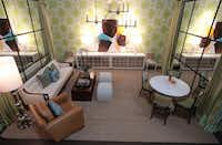A trio of modern Sputnik-style fixtures are set off against a bold apple-green wallpaper in Lisa Luby Ryan's vignette. The light fixtures aren't the only items with sparkle in her room. Two pieces of white laquered furniture with mirrored fronts, as well as a shiny floor lamp, amp up the glam factor.