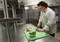 Nancy Maslonka, executive chef of Medical City Dallas Hospital and Medical City Children's Hospital, prepares a nutrient-rich broccoli dish called Sesame Roasted Broccoli.(Kye R. Lee - Staff Photographer)