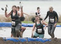 Women competing in the Dirty Girl Mud Run at Cedar Hill State Park on Saturday, Oct. 6, 2012.(Rex C. Curry)
