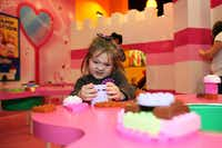 Brylie Butler, 4, struggles a bit while building with Lego blocks at the Princess Palace Karaoke room inside the LegoLand Discovery Center, on Oct. 07, 2012 at Grapevine Mills Mall in Grapevine. Ben Torres/Special Contributor