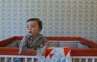 Designer Erin Sander has created a colorful nursery for her first son, Ryan Sander, six-months, in their Dallas, Texas home. The two posed for pictures on Friday, September 07, 2012.