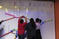 Engineering Week at the Fort Worth Museum Science and History runs from Feb. 21-26, 2012. Participants build a roller coaster out of paper.