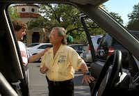 Valet Dave Ward talks with regular Corbin Wynn, left as he parks cars at the Mi Cocina at Highland Park VIllage in Dallas on Wednesday, May 8, 2013.