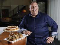 "Chef Kent Rathbun poses for a photo with his ""Thanksgiving To Go"" dishes, pumpkin cheesecake with caramel and smoked chicken stuffing, at his home in Dallas, Friday, Nov. 8, 2013."
