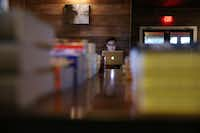 Joe Peters of Dallas works on his laptop at The Wild Detectives, which opened several months ago.(Andy Jacobsohn - Staff Photographer)