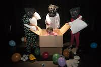 """Jeff Colangelo, in box, and the characters known as the Pillomen, perform a scene from """"Playtime"""", at the Bath House Cultural Center on Friday, July 11, 2014.  The play, written by Colangelo, is part of Festival of Independent Theatres.(Rex C. Curry - Special Contributor)"""