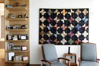 "The condo's decor includes Cecilia Boone's quilts, including a log cabin-style design titled ""I Get By With a Little Help From My Friends."""