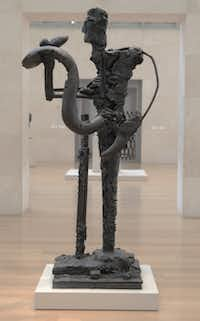 """This bronze sculpture titled, """"Man with Snake III"""", 2000-01, is on display at the Nasher Sculpture Center in Dallas. The Modern and the Nasher Sculpture Center, present a joint exhibition of the work of artist David Bates, of Dallas, on view February 9 through May 11, 2014. The exhibition is a retrospective of Bates's work installed in both locations with an emphasis on painting in Fort Worth and sculpture and works on paper in Dallas. This is the first collaboration between the two museums. Shot on Wednesday, February 12,2014."""
