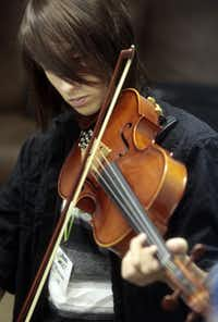 Nicholas Langlois , 15, plays the viola in a class taught by Marcus Pyle, a 23-year-old Juilliard student from Garland, at his Chamber Works Music Camp at the First United Methodist Church in Garland Texas, on July 12, 2013.