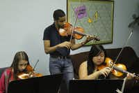 Marcus Pyle, left, a 23-year-old Juilliard student from Garland, teaches a class at his Chamber Works Music Camp at the First United Methodist Church in Garland Texas, on July 12, 2013. The class included, l to r, Clara Truax, 13 and Tien Huynh, 16.
