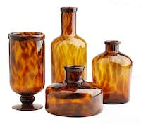 Animal Attraction: Hand-blown, glass candleholder and decorative jars reflect warm shades of gold and chocolate brown in a tortoise shell pattern. Pillar holder $70; tall jar $72.50; short jar $60; medium jar $48 at Nicholson-Hardie Garden & Nursery, Dallas. Photographed at DMN studio on September 12, 2013.