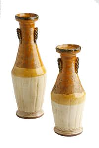 Light Up Fall: In shades of brown, cream and gold inspired by ancient Roman fruit baskets and torch holders, Montelupo pillar candleholders are a handsome autumn accent. 15.75-inches tall $189 and 19.75-inches tall $230 at Culinary Connection, Plano and vietri.com. Photographed at DMN studio on September 12, 2013.