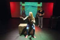 """Cara L. Reid, front, and Whitney Holotik perform a scene from """"mani/gift"""" at the Bath House Cultural Center on Friday, July 12, 2014.  The play is part of Festival of Independent Theatres.(Rex C. Curry - Special Contributor)"""