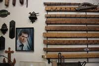 Some of Lynn Dowd's collection of measuring sticks with a signed portrait of at Dowd's Vintage and Antique Tools in Garland September 12, 2012.