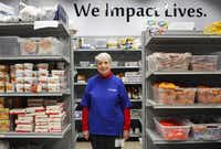 Shift coordinator Betsy Vandament of Richardson volunteers in the food bank at Network of Community Ministries. According to Vandament, who has volunteered since she retired from teaching, the experience is humbling and uplifting.( Staff photo by Jim Tuttle  -  DMN )