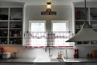 Selena Urquhart's creative 30-day blast of creativity included making curtains for the kitchen window.