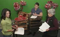 """Vanessa DeSilvio, left, and David Lugo, center, go through scenes of """"Mariachi Girl"""" with Dallas Children's Theater executive artistic director Robyn Flatt."""