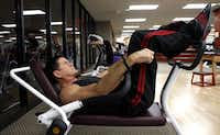 Ted Gambordella demonstrates how he does situps at Dallas Lifetime Athletic in Dallas on Friday, February 15, 2013. He will celebrate his 65th birthday on the 22nd by doing his 6 millionth crunch.