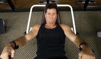 Ted Gambordella demonstrates his routine for sit-ups at Dallas Lifetime Athletic  He plans to celebrate his 65th birthday by doing lifetime sit-up No. 6 million.