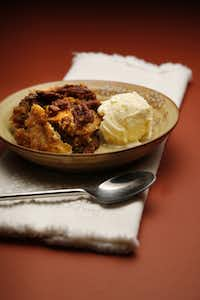 Pecan Cobbler with Sorghum Syrup with ice cream, bowl: World Market.