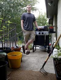 Corey Stefanowicz, 26, raises vegetables, culinary herbs and strawberries in containers on the porch of his Oak Cliff apartment.(Lara Solt - Staff Photographer)
