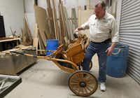 """""""There's not a local horse-and-buggy repair guy, so I guess it comes here,"""" Hornor says, showing a miniature horse-drawn carriage that was brought into his shop.Mona Reeder"""