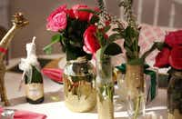 For her Pop! Fizz! Clink! celebration, Smrekar chose pinks, gold and glitter. Canning jars and grocery store bouquets become centerpiece showstoppers with some glue and gold glitter.