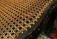 A detail shot of a finished handwoven rush seat for a chair restored by Louise Herriott at her home in Dallas on Tuesday, August 21, 2012.