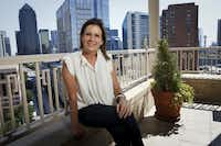 Linda Owen poses for a portrait on the balcony at her home overlooking downtown on Sept. 21, 2011 in Dallas. (Patrick T. Fallon/The Dallas Morning News)