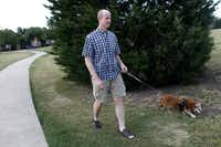 Matt Wixon walking his dog Maggie, in Plano on May 21, 2012.