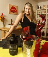 "Susan D. Owens, a former Playboy Bunny , now bottles the highly-successful perfume ""Child"", pictured in her garage workshop in Dallas, on August 22, 2013. The fragrance is a best seller in Los Angeles Boutiques.(Michael Ainsworth - Staff Photographer)"