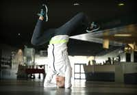Team USA figure skater Ashley Cain, 16, of Coppell performs a head stand to work on her balance at the Dr Pepper Star Center in Euless, Wednesday, January 22, 2014. Cain is a 4-time National medalist who hopes to compete in the 2018 Olympics.