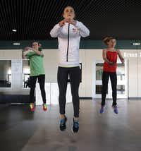 Team USA figure skater Ashley Cain works out by doing leaps during her father/coach, Peter Cain, led practice at the Dr Pepper Star Center in Euless, Wednesday, January 22, 2014. Cain is a 4-time National medalist who hopes to compete in the 2018 Olympics.