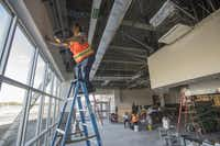 A construction crew works to build Wylie High School's The 544 cafe, the latest of many construction projects at Wylie High.(Rex C. Curry - Special Contributor)
