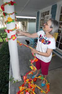 Lurline Russell of Lake Highlands makes a practice yarn-bombing run at the Shabby Sheepin State-Thomas.