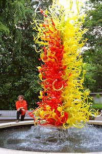 Renowned Seattle glass artist Dale Chihuly with one of his garden installations.