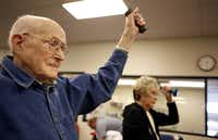 Vernon Chambliss, 99, lifts weights in an active lifestyle exercise class at Baylor Medical Center.