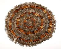 Feathered edge: Pheasant plumage radiates from the center of 18-inch-round place mats. $140 for a set of six from the Ivy House, Dallas.