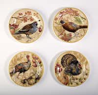 Bird watching: Stoneware featuring autumn birds and botanicals set a seasonal table. The boxed set of four is $49.50 at Pottery Barn, multiple locations, and potterybarn.com.